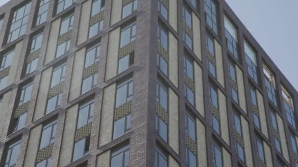 Residential building in New microdistrict. Close up Of An Apartment Blocks. The building features exterior