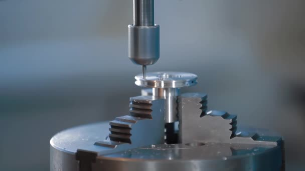 Cutting metal modern processing technology. Milling is the process of machining using rotary cutters to remove material by advancing a cutter into a workpiece. Fine cut end mill shaving block of metal