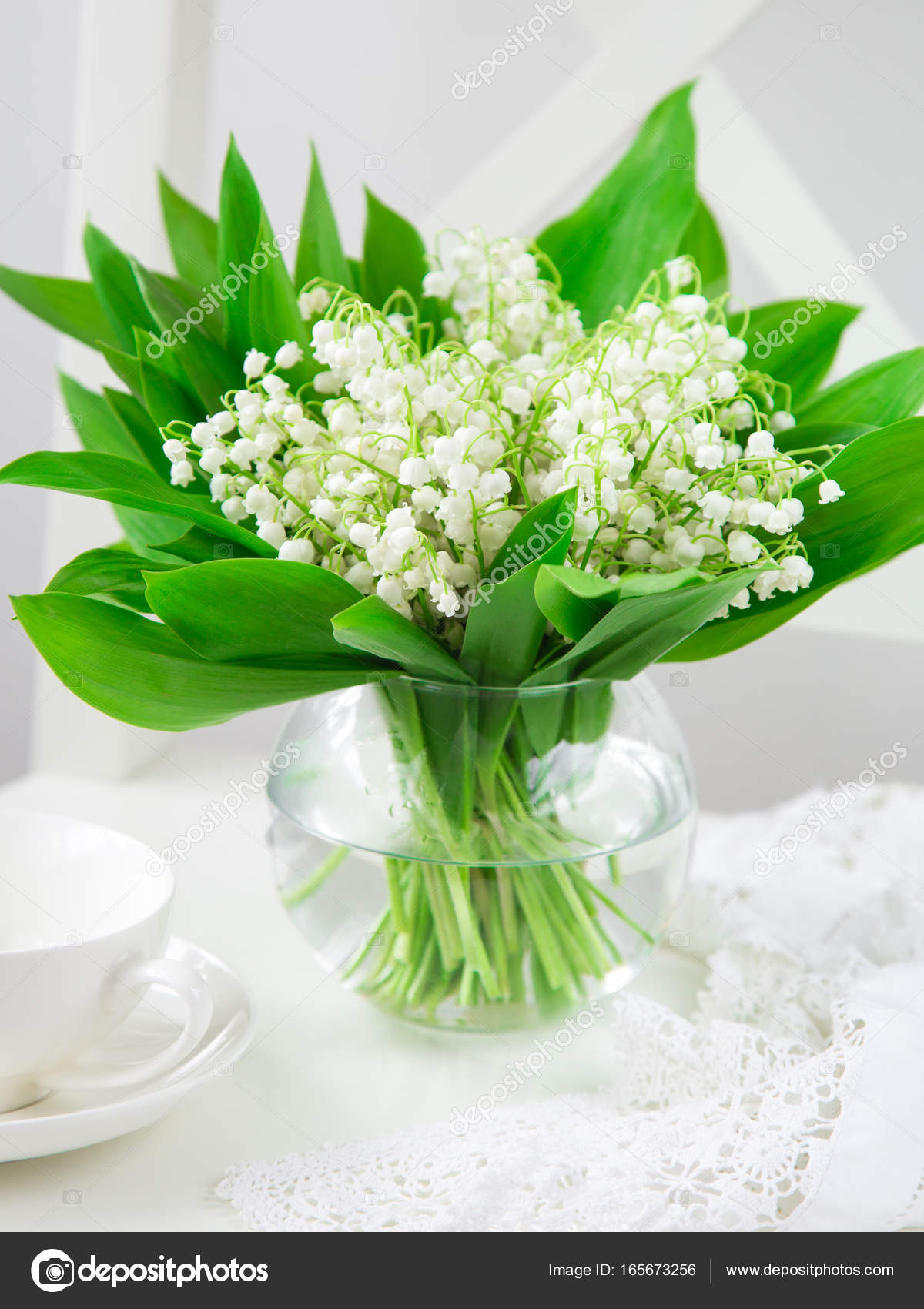 Lily of the valley flowers in vase stock photo annashepulova lily of the valley flowers in vase stock photo izmirmasajfo Choice Image