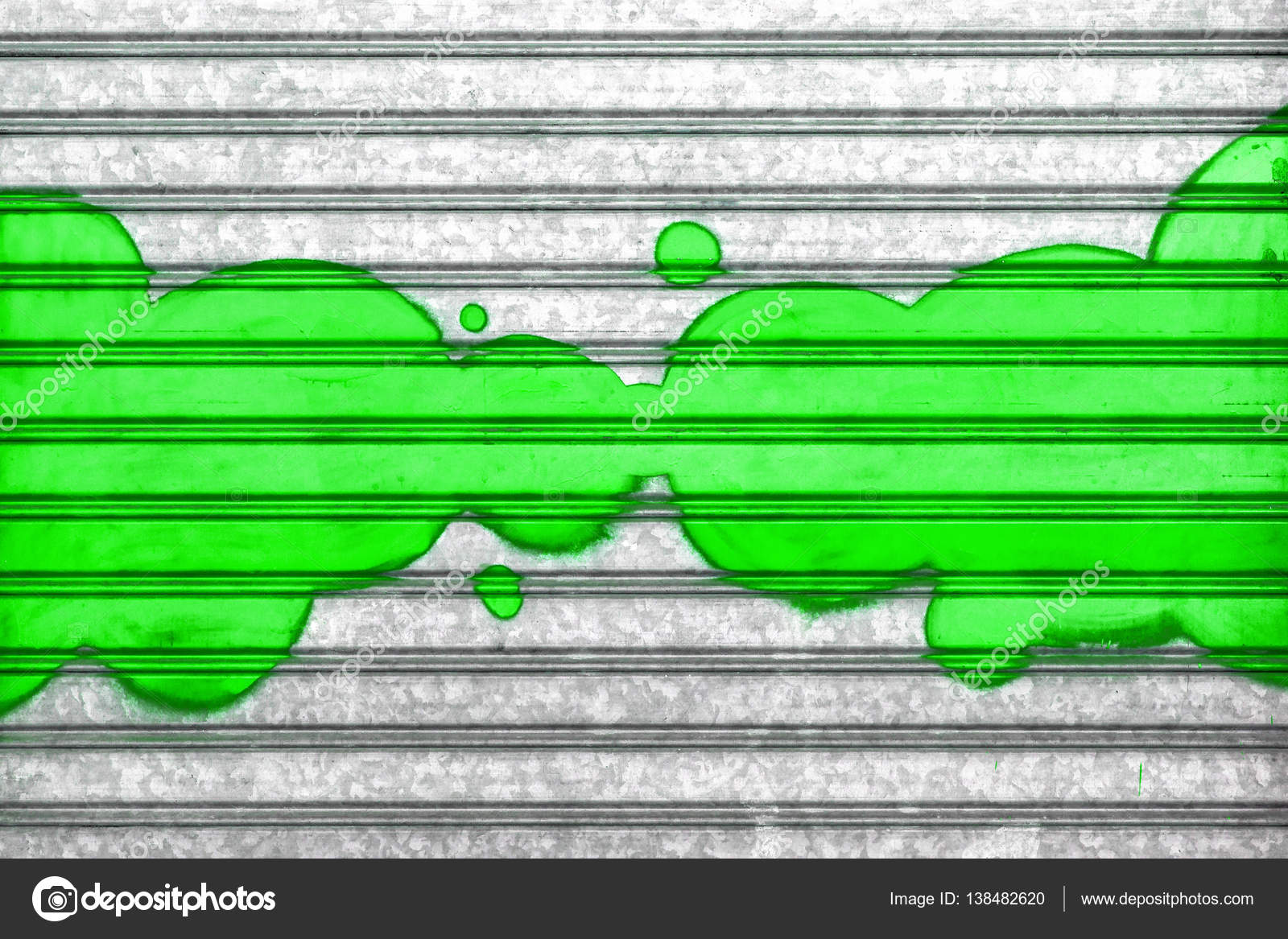 Green bubbles painted with spray paint on a roller shutter