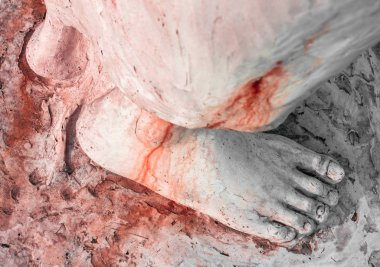 Foot of Christ bloodied