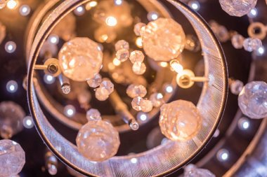 A cut glass chandeliere closeup at night