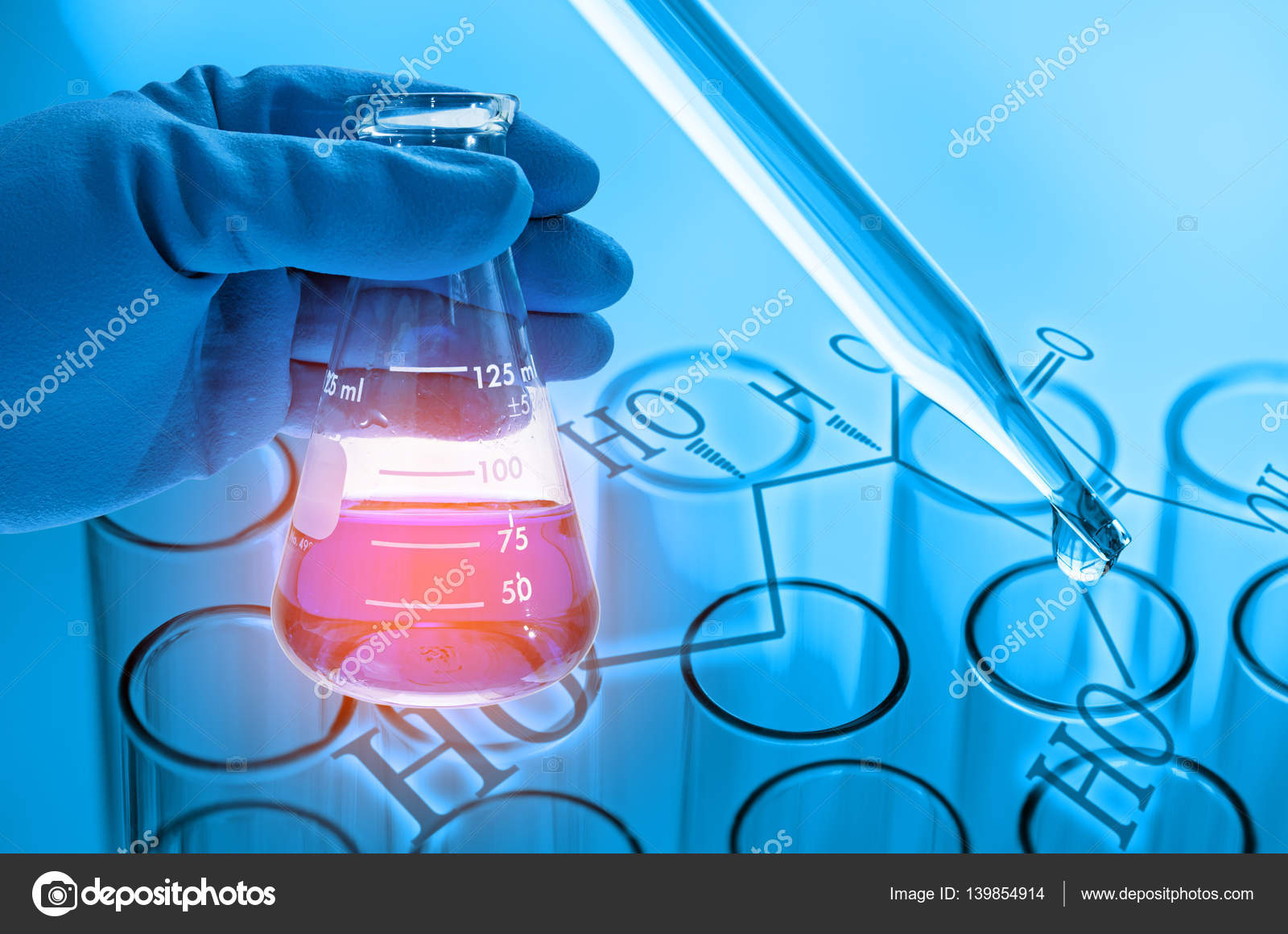 scientist hand holding laboratory flask with laboratory test tub ...