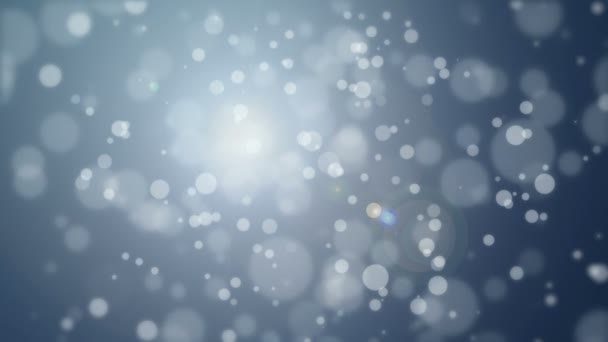Dark grey blue bokeh background with floating light particles.