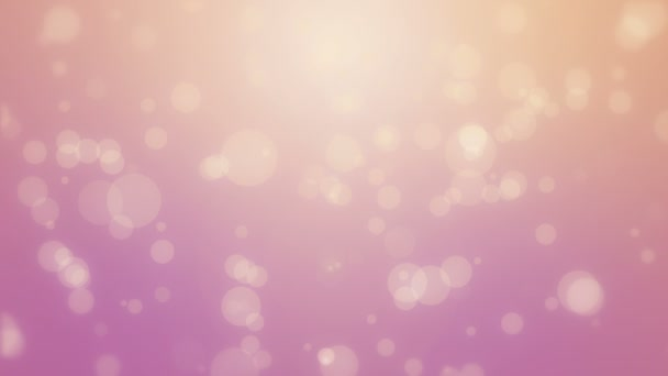 Pink orange glowing bokeh background with floating light particles.