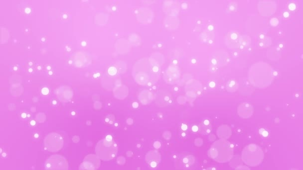 Glowing pink bokeh background with moving light particles.