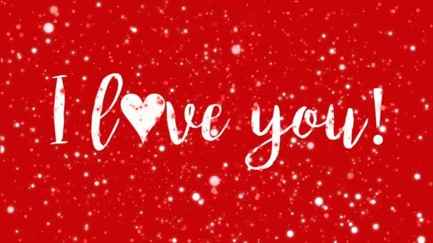 Csillogó piros animált Valentin-napi üdvözlőlap I love you kézzel írott szöveg és villogó fény részecskék.