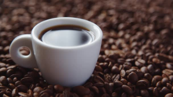 Hot coffee and roasted coffee beans