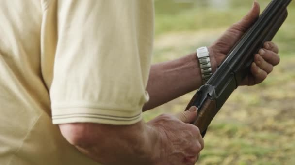 man makes a shot from a hunting rifle