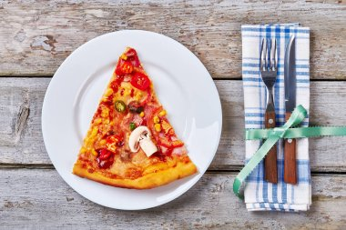 Plate with slice of pizza.