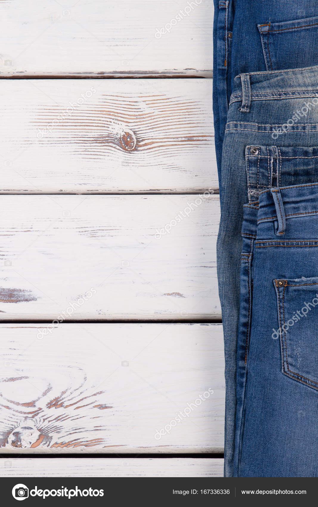 343120ba823 Новая коллекция джинсов на деревянной полке. Идеальный фон для магазина  объявления