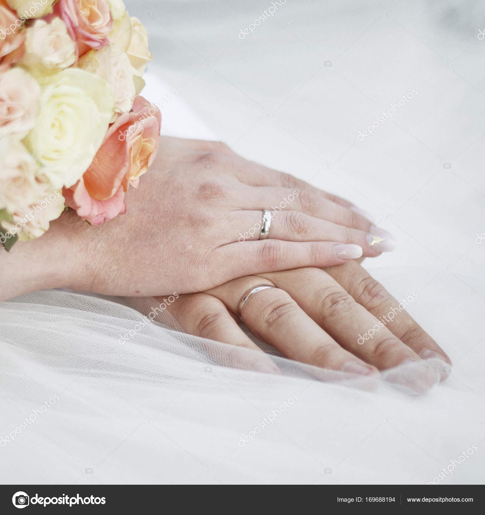 newlyweds hands with wedding rings. — Stock Photo © Ukususha #169688194