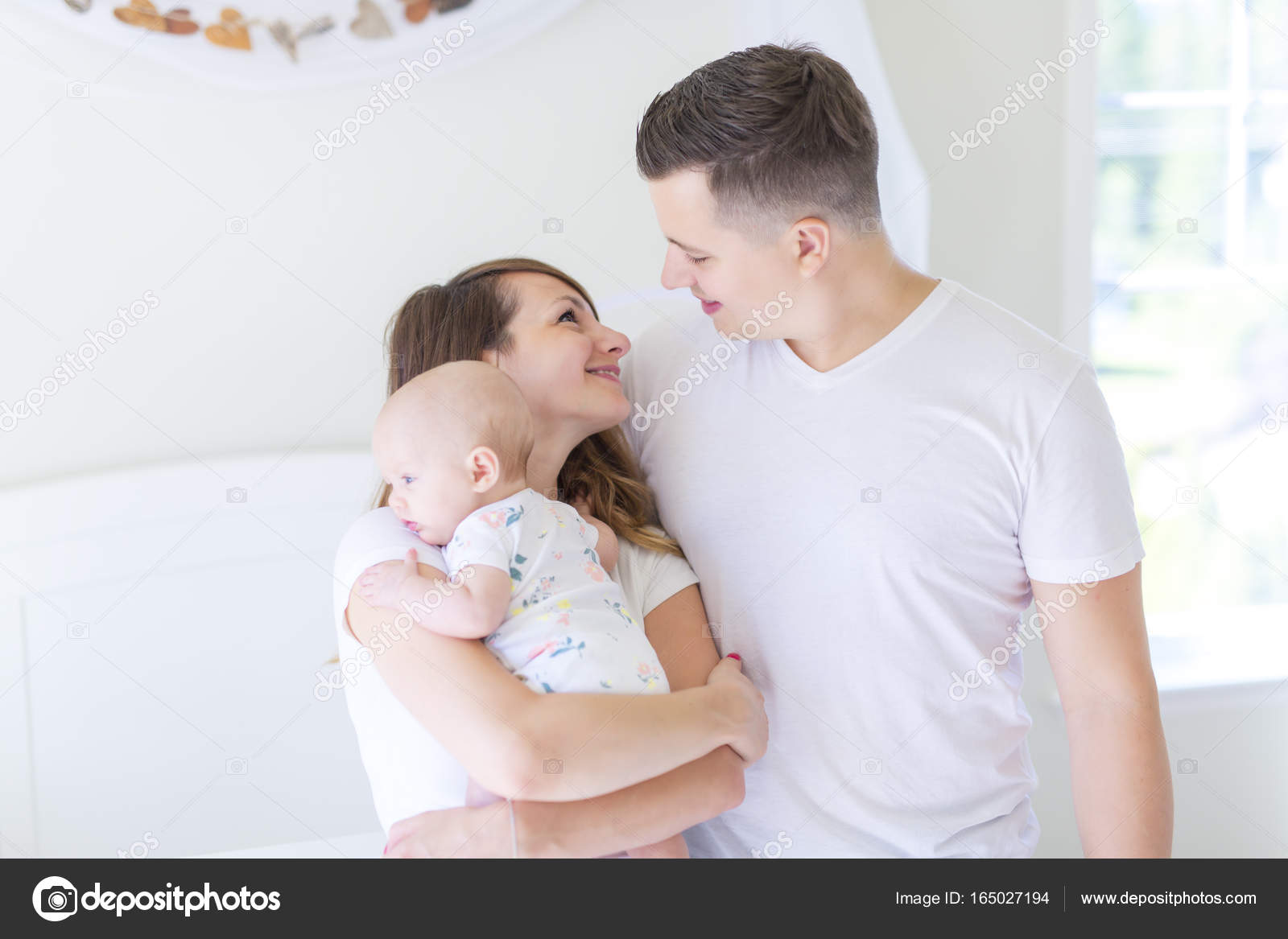 portrait of parent with her 3 month old baby stock photo lopolo