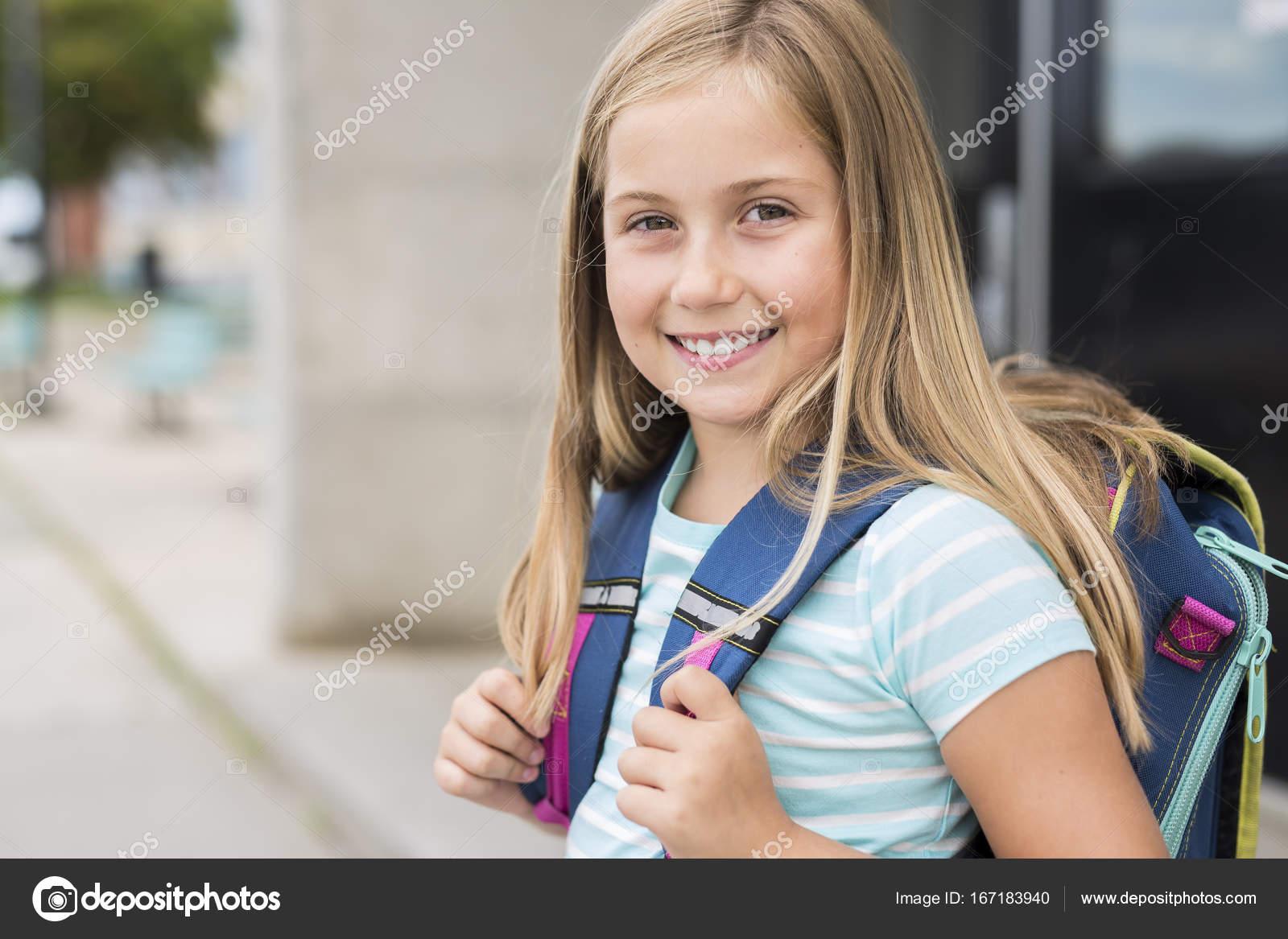 depositphotos_167183940-stock-photo-nine-years-old-girl-student.jpg