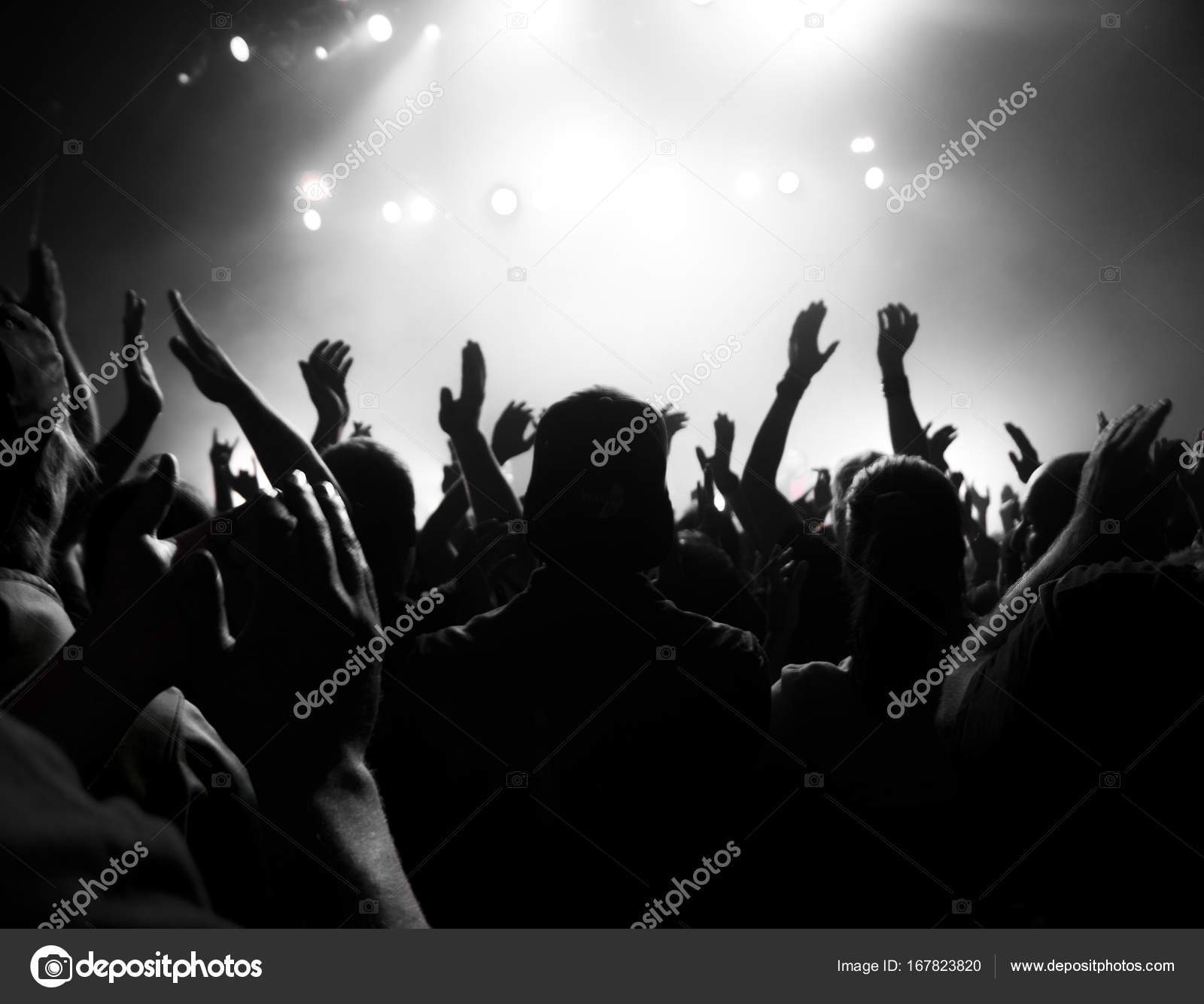 A crowd shadow of people at during a concert — Photo by Lopolo 289d15974781