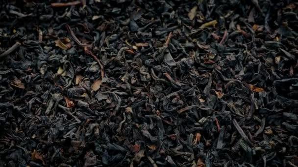 Černý čaj listy, rotující Closeup