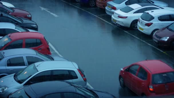 Cars Driving In Parking Lot On Rainy Day