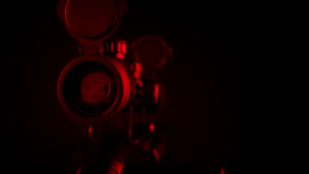 Rifle Scope Comes Into View In Red Light