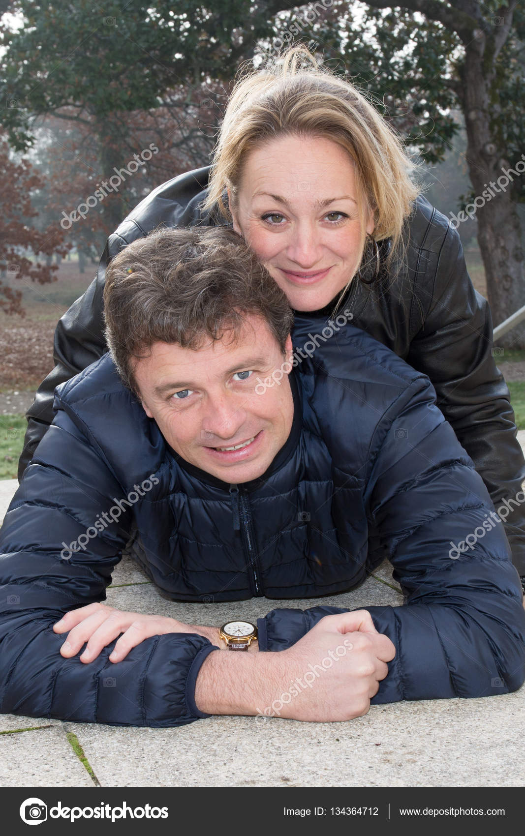 an happy couple outdoor, mature blonde woman with man in autumn day