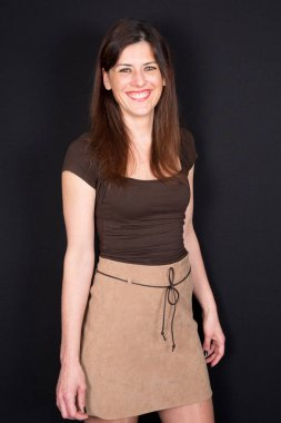 Portrait of middle-aged Pretty Woman Smiling in brown clothes