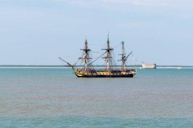 rochefort , Aquitaine / France - 01 15 2020 : frigate boat Hermione Lafayette ancient new vessel in atlantic ocean with fort boyard background
