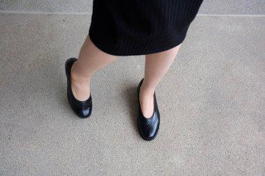 Slim Legs Woman Wear Black Dress and Black Shoes on Street Background