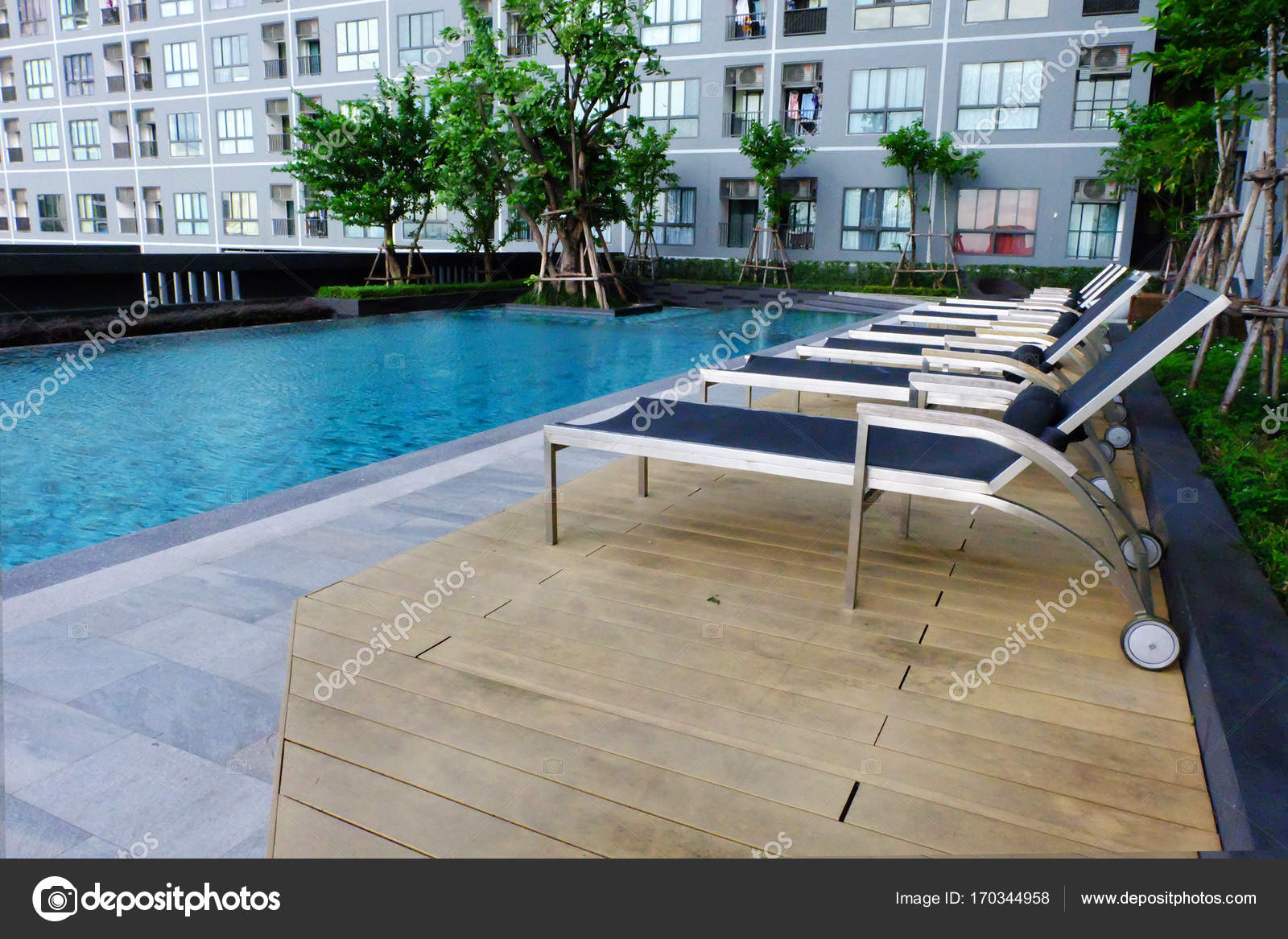 Blue Swimming Pool With Empty Chairs, Pool Chair For Relax Background Great  For Any Use. U2014 Photo By Yayha