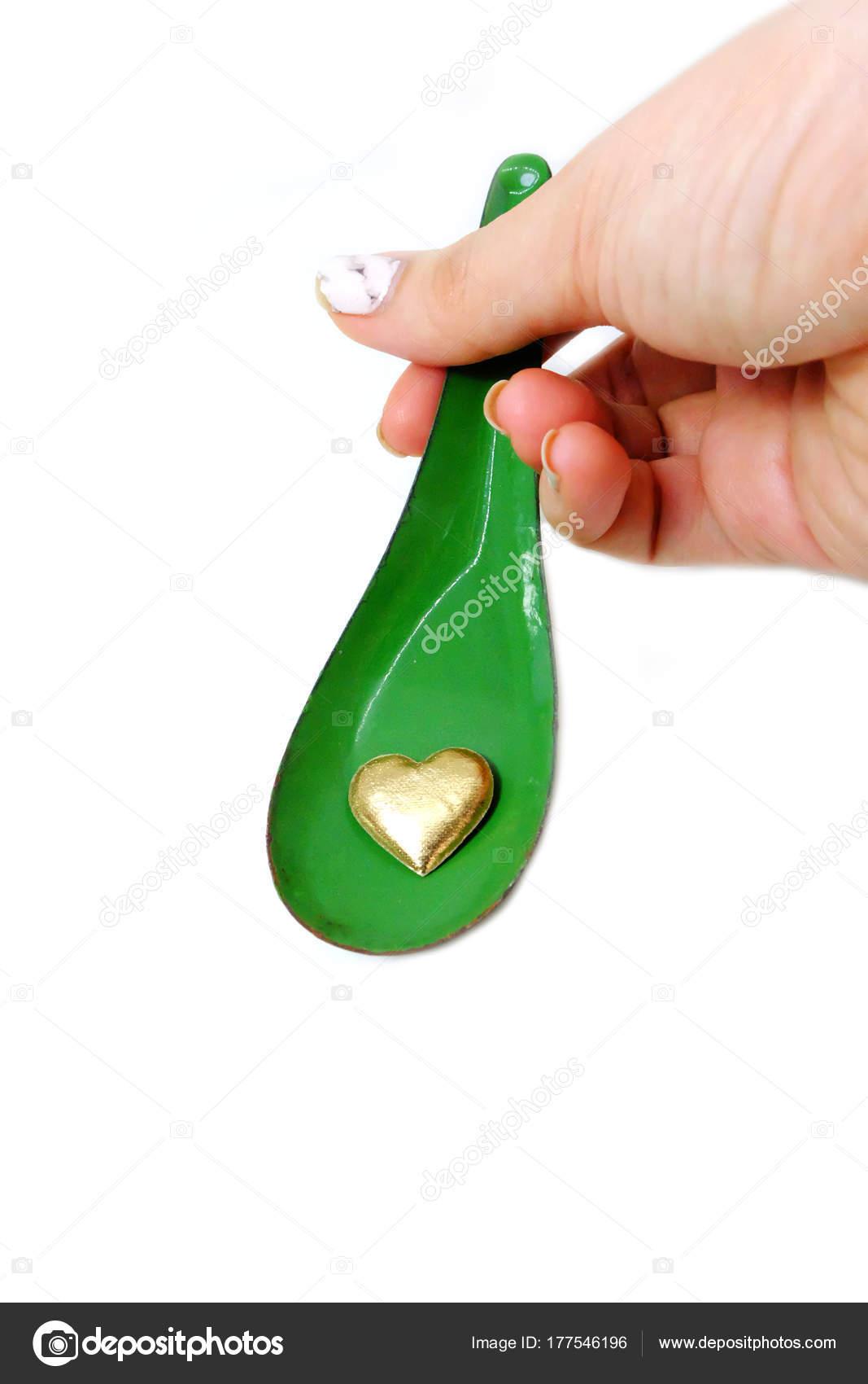Mano Mujer Con Granito Cuidado Uñas Sosteniendo Cuchara Corazón Oro ...