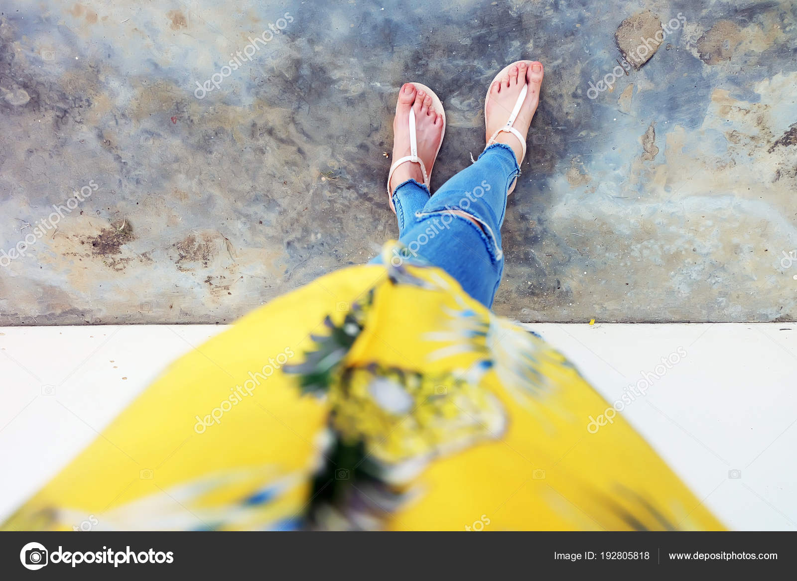 78e6ebdf7227 Nude Shoes Woman and Yellow Pineapple Shirt Accessories. Close Up on Girl s  Feet Wearing Nude Sandals and Lack of Blue Jeans on Street Road in The City  ...