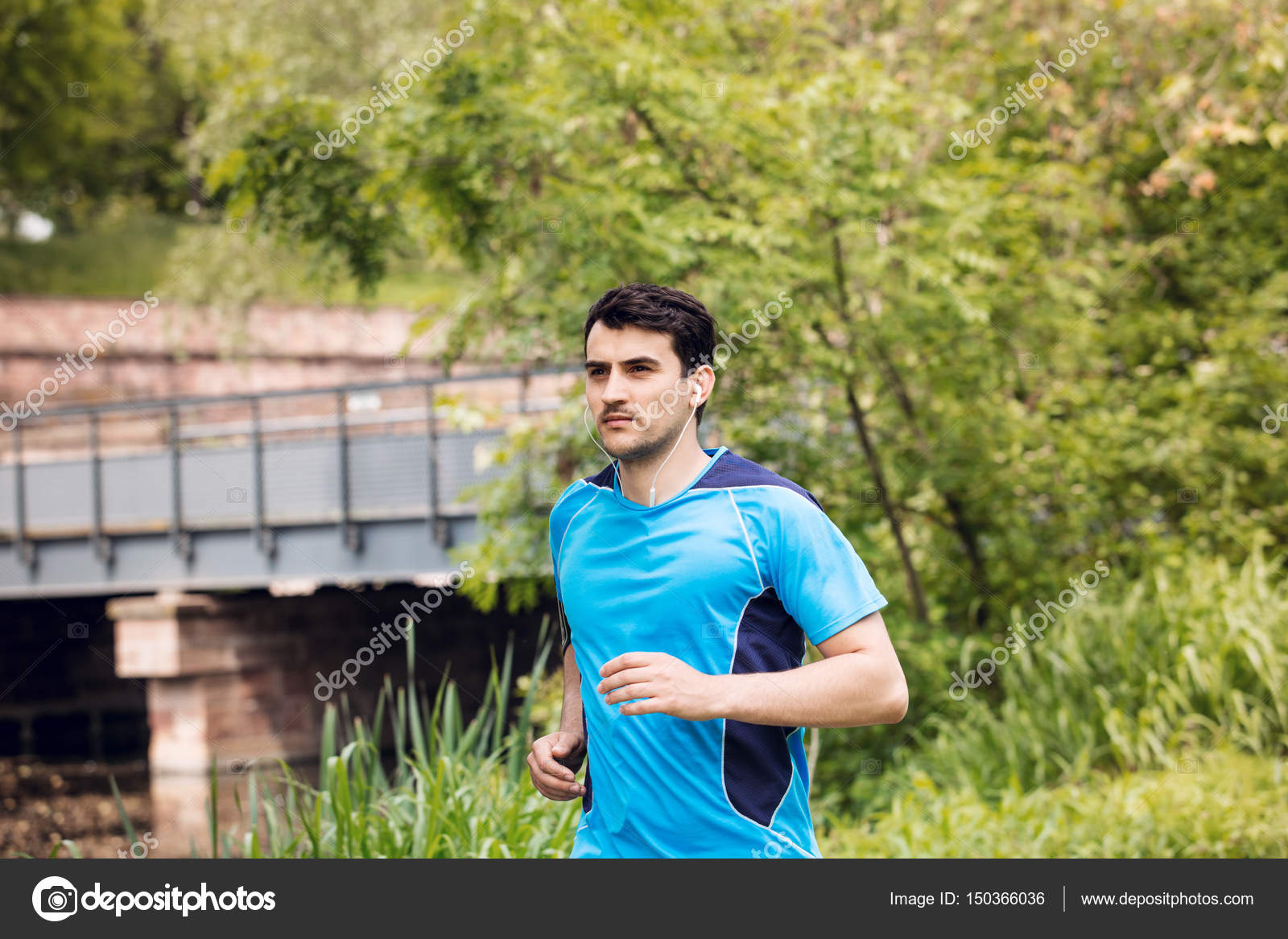 Running workout man with mp3 music player listening to music — Stock