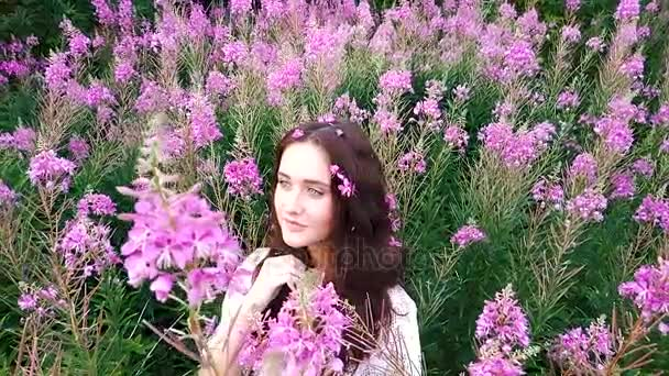 Young woman in flowers