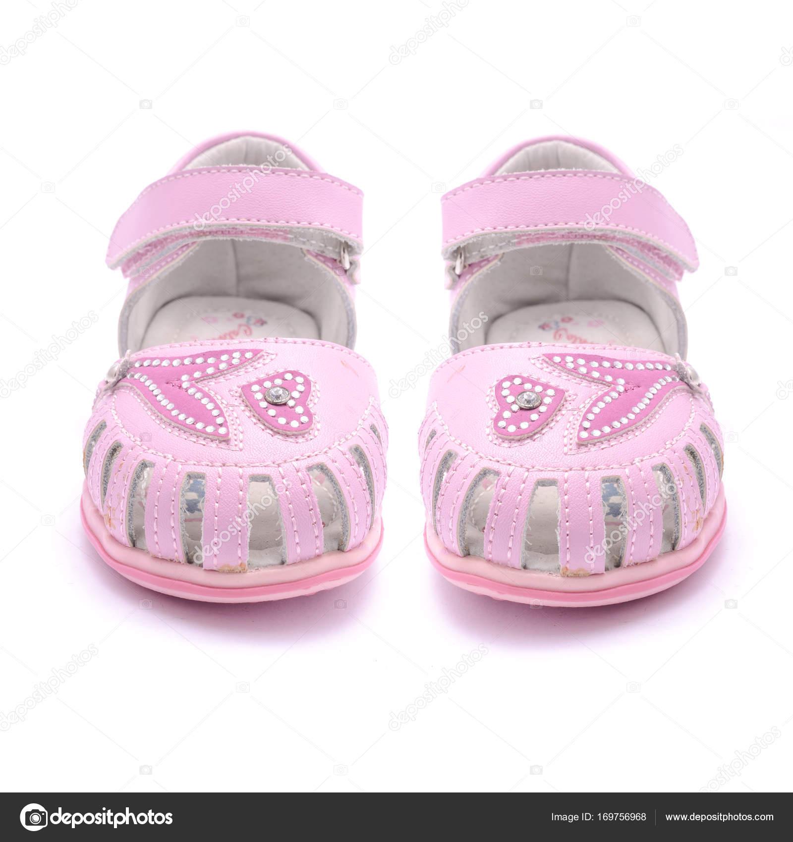 6141054c4b3 Ροζ πέδιλα για το μωρό που απομονώνονται σε λευκό — Φωτογραφία Αρχείου