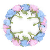 Photo round wreath with pink and blue roses isolated on white