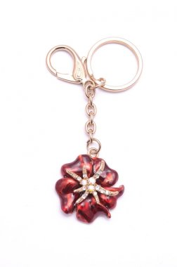 gold keyring with a flower isolated on white