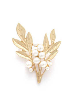 Golden brooch twig with pearls isolated on white