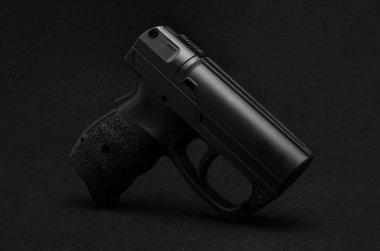 Black pistol on black background stock vector