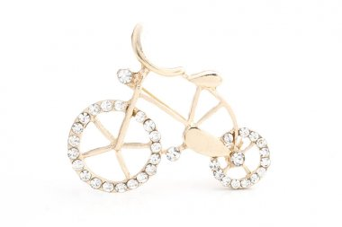 golden brooch bicycle with gems isolated on white