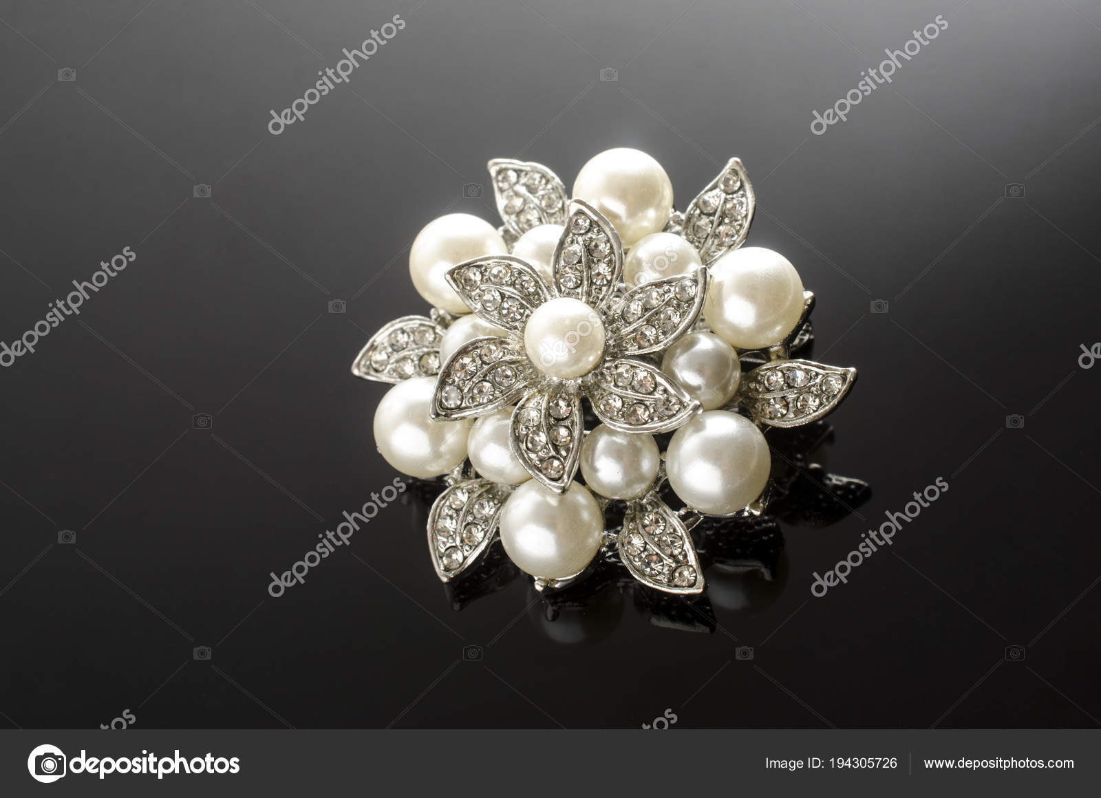 d6079abed66b6 Silver brooch flower with pearl isolated on black — Stock Photo ...