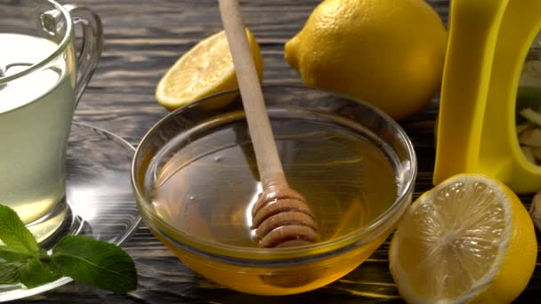 Ginger tea with lemon, mint and honey on wooden background.