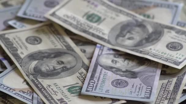 Rotace papírové peníze. Pozadí s peníze americký sto dolarové bankovky