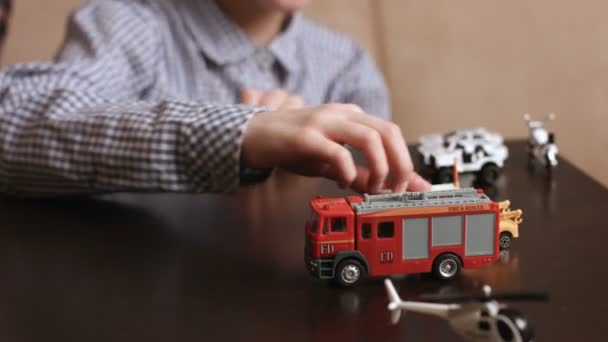 Boys play with toy cars.