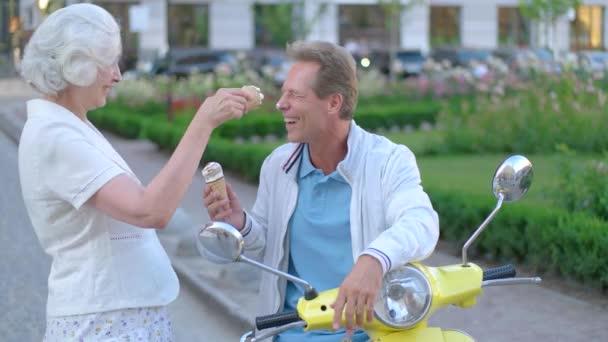 Ice cream on mans nose.