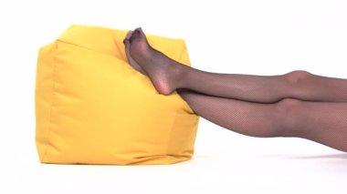 Feet lying on pillow.