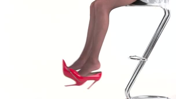 Legs and red heels.