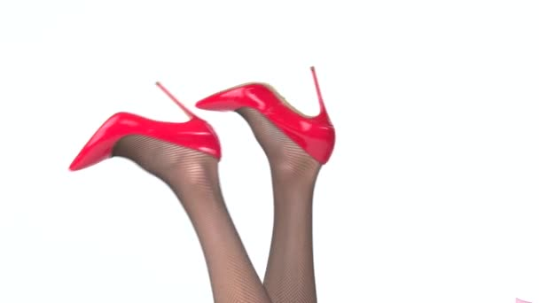 Womans legs in shoes isolated.