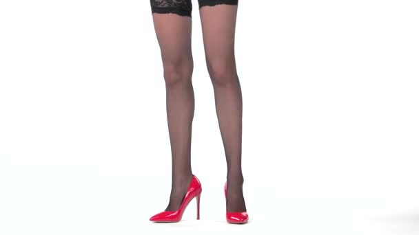 Isolated female legs with shoes.