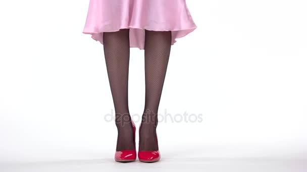 Legs in heels standing.
