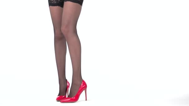 Isolated ladys legs in shoes.