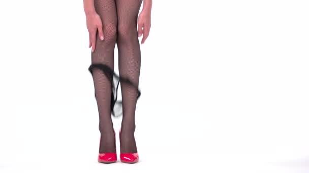 Woman taking off panties.