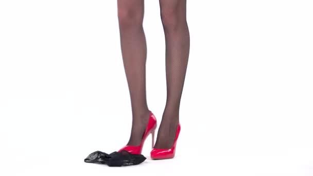 Legs wearing red heels.